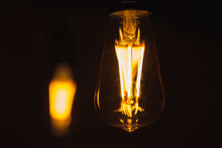Tungsten lamps glow in the dark, close-up photo with selective soft focus