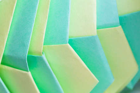 Origami background, abstract parametric structure made of colorful paper sheets
