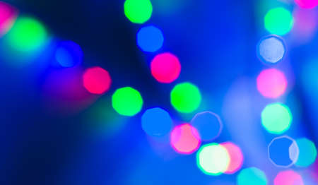 Colorful lights bokeh over blue background. Abstract background photo