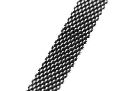 Braided silver bracelet on a white background, close up photo with selective focus