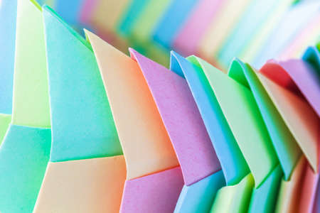 Origami background, abstract parametric structure made of colorful paper sheets, close up photo with selective soft focus 版權商用圖片
