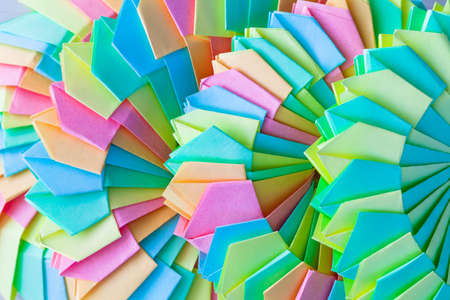 Origami background, abstract parametric spiral structures of colorful paper sheets, close up photo with selective soft focus 版權商用圖片