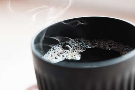 Cup of hot black filter coffee with steam, close up photo with selective soft focus 版權商用圖片