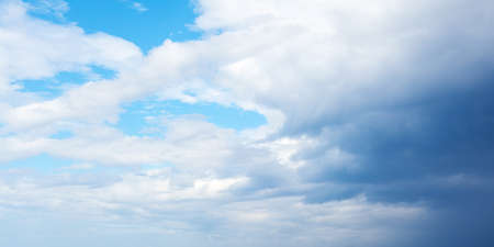 Blue sky with white cumulus clouds on a daytime. Natural panoramic background photo texture