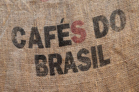 Standard marking text for Brazilian coffee on a jute shipping bag, background photo