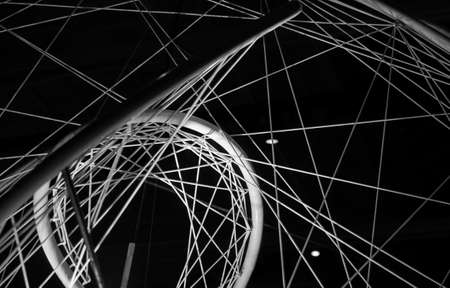 Abstract high tech black and white photo with parametric steel structure over dark background