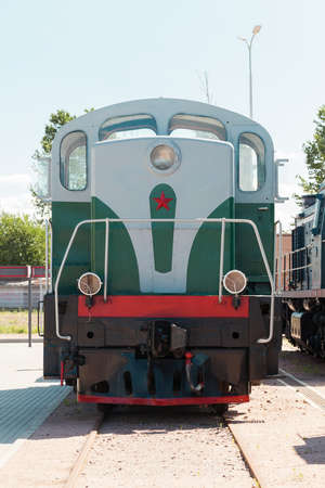 Vintage Soviet diesel locomotive is on a railway on a sunny day, close-up front view 版權商用圖片