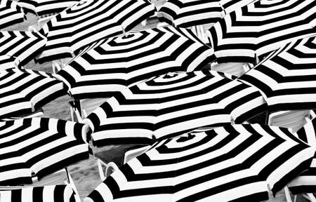 Umbrellas with striped pattern. Abstract background black and white photo