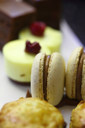 English tea with scones, macaroons and cakes photo