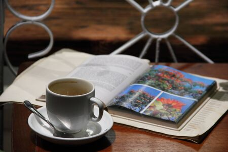 drank: Cup of coffee with an open book