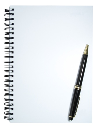 A blank notebook with a pen resting on it. The pen is positioned in a slanted position. Isolated on a white background.  photo