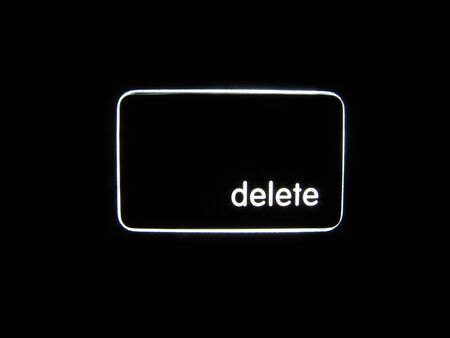 backlit keyboard: A backlit Delete button isolated on a black background