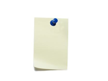 A yellow post-it with push pin isolated on a white background photo