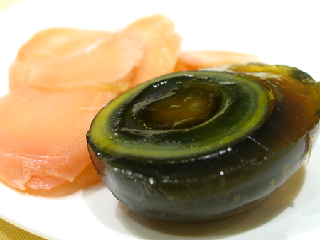 Cantonese century egg served with ginger slices Stock Photo