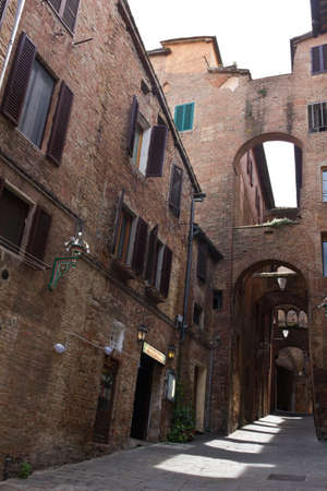 siena italy: Rustic walkway in the historic city centre of Siena, Italy Stock Photo