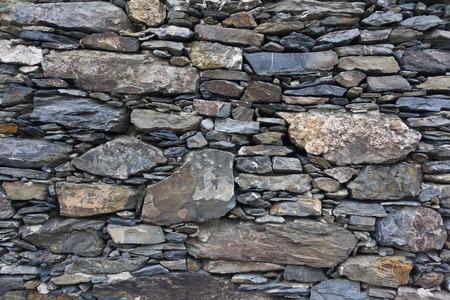 cinque: Rustic wall made of shale rock in Cinque Terre