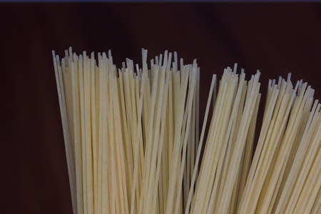 angel hair: Uncooked angel hair pasta isolated on black background Stock Photo