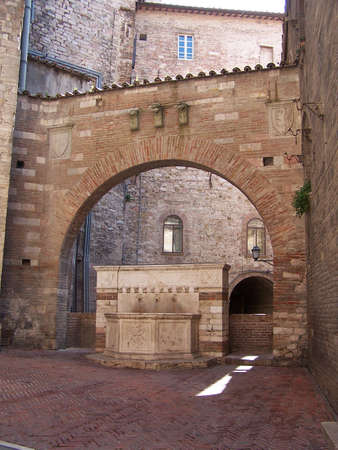 medioeval: Medioeval fountain and archway in Perugia