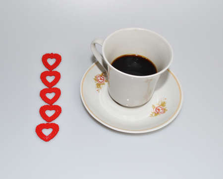Valentines day - little red hearts and a cup of coffee