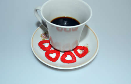 Valentine's day - little red hearts and a cup of coffee Banco de Imagens - 95207280