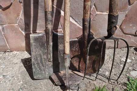 agricultural tools - shovel, pitchfork, ax, saw