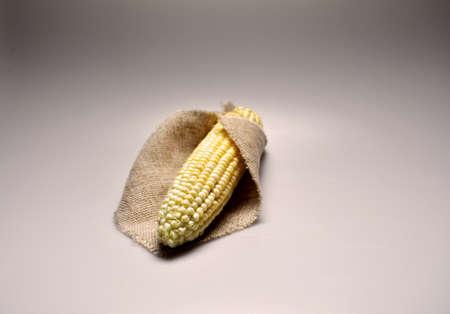 vegetative, vegetarian food - juicy yellow corn, corn cobs, grains