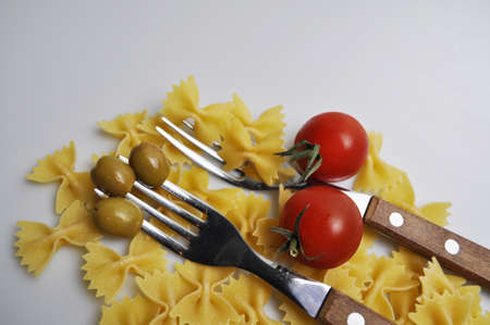 pasta with red cherry tomatoes and green olives Banco de Imagens