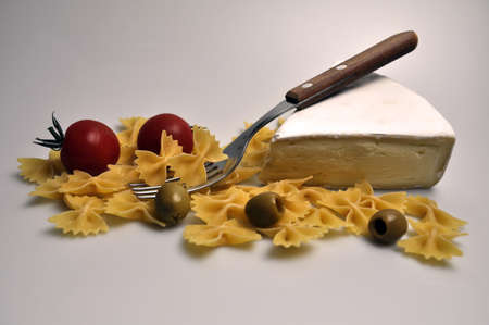 white cheese with tomatoes, olives and pasta Banco de Imagens