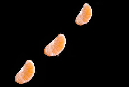 Ripe lobules of mandarins in flight Stock Photo