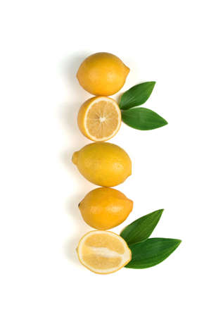 Ripe and fragrant yellow lemon with green leaves. Lemons isolated on white background. 免版税图像