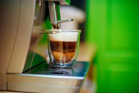 Close-up of espresso pouring from coffee machine. Professional coffee brewing Stock fotó