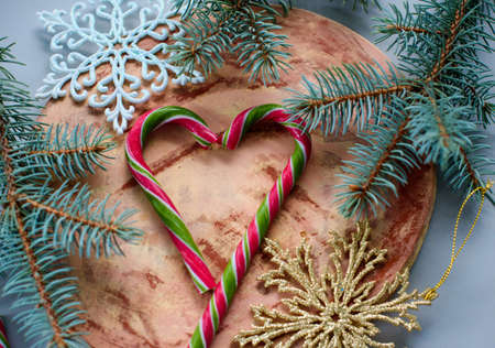New Years decor, spruce twigs, snowflakes, heart made of candy. holiday, christmas