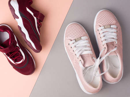 Sports shoes on a colorful background. View from above. Place for text. Flat lay