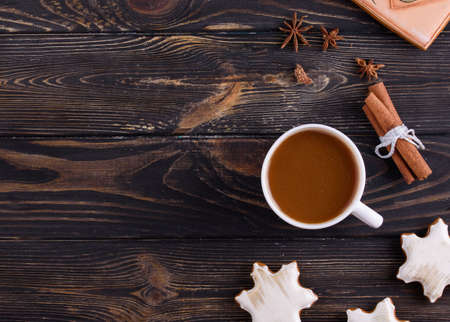 Christmas gingerbread cookies on a wooden background with aromatic coffee and cinnamon sticks. Holidays concept Stockfoto
