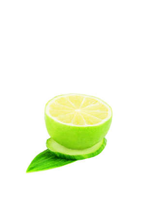 Fresh lime cut in half on a white background with green leaves.