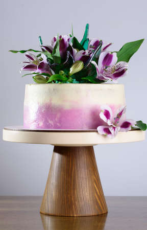 A beautiful holiday cake decorated with fresh flowers. Holidays