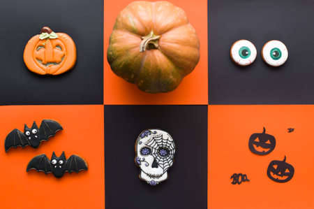 Halloween conten parties and decorations. Black-orange background and gingerbread cookies. Decor