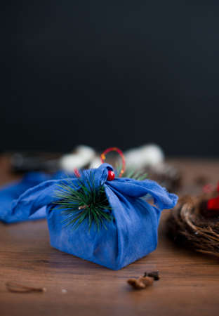 Christmas furoshiki wrapping. Etnical hristmas gift. Zero-waste christmas guide.