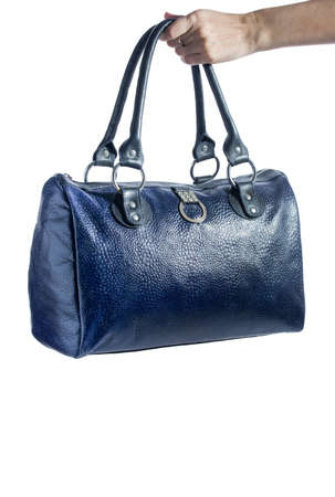 Beautiful leather travel blue bag isolated on a white background.