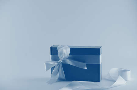 Gift box with blue ribbon in neon light,