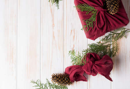 Christmas furoshiki wrapping. Etnical hristmas gift. Zero waste concept 2020 Stok Fotoğraf