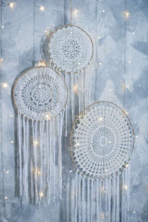 Beautiful dream catcher on the wall with lights. Boho handmade. Style