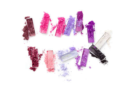 Multi-colored races of eye shadows, different colors are isolated on a white background. Cosmetics and beauty