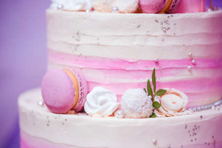 Beautiful birthday cake of several tiers in a gently pink range. Birthday. Stock Photo