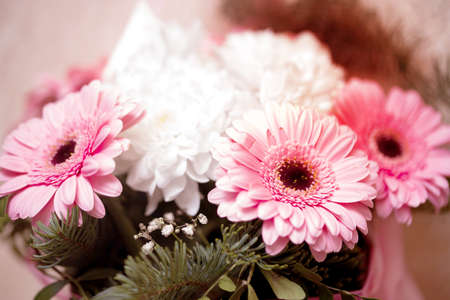 A beautiful bouquet of flowers from chrysanthemums and gerberas in a delicate pink toning. Festive bouquet.