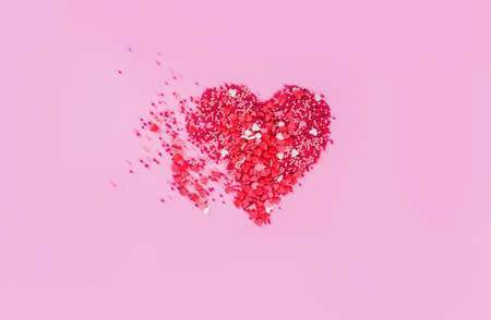 Heart on a pink background of small hearts. Content for Valentines Day.