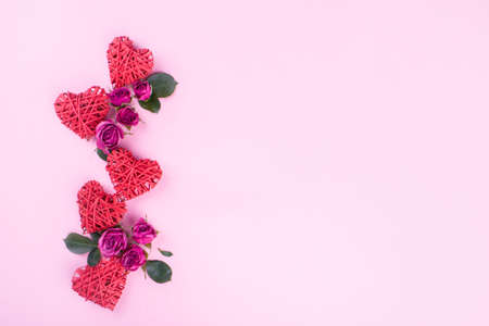 Beautiful roses with hearts on a pink background, content for Valentines Day. Background for writing and advertising.