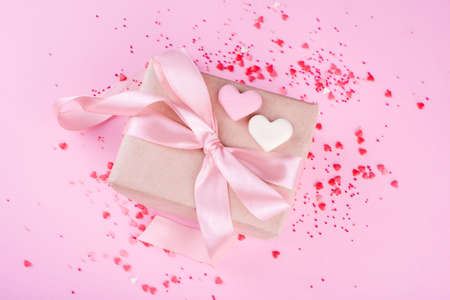 Beautiful box with satin ribbon, with small hearts, chocolate hearts of milk chocolate. Valentines Day.