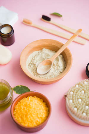 Cosmetic bath salt, grape gomaj for the face, coffee scrub for the body on a pink background. Zero wase, eco, organic cosmetic.