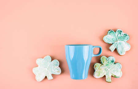 March 17 is St. Patrick's Day. Composition of sweet gingerbread on a light background. A place for text.